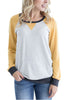 Front view of woman in yellow elbow patch sweatshirt