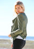 Left side view of girl in Studded Shoulder Denim Blazer - Green