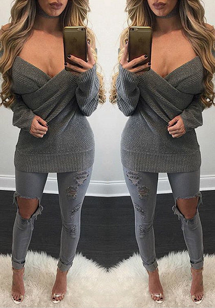 Two mirror shots of model in dark grey ribbed wrap sweater
