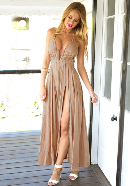 Voluptuous woman in cameo color strappy plunge dress