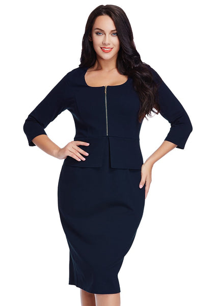 Woman in plus size navy blue zip-up pencil dress poses with hands on hips