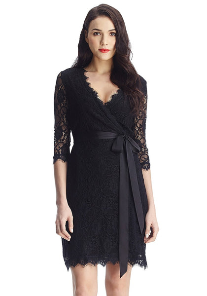Woman wearing black lace overlay plunge wrap-style dress