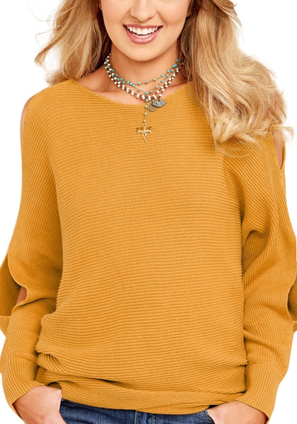 Woman wearing mustard yellow cutout slit sweater