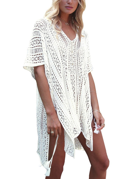 Woman wearing pretty white crochet lace-up side beach cover-up