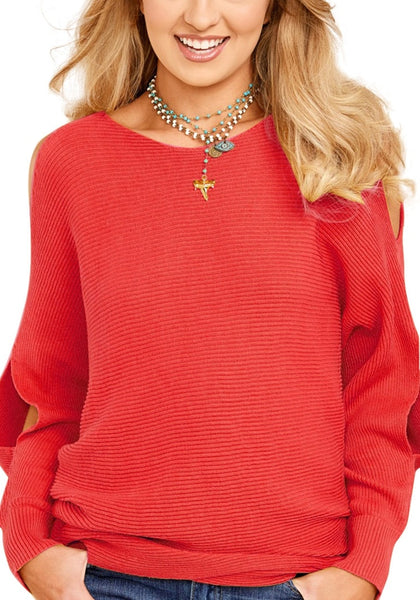 Woman wearing red cutout slit sweater