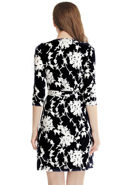 back shot of model in black floral plunge wrap dress