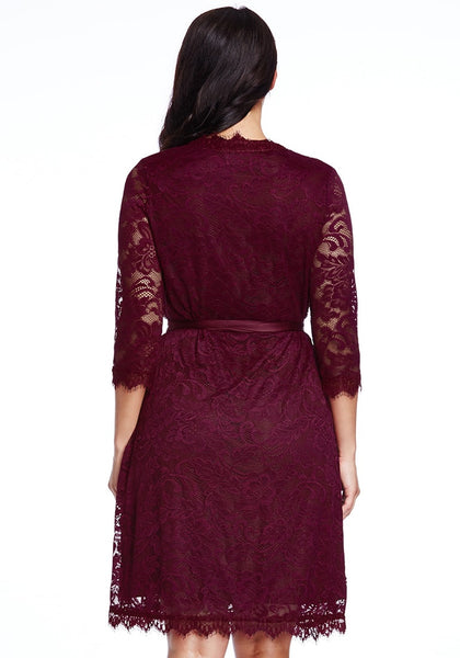 back shot of model in plus size burgundy lace crop sleeves wrap dress