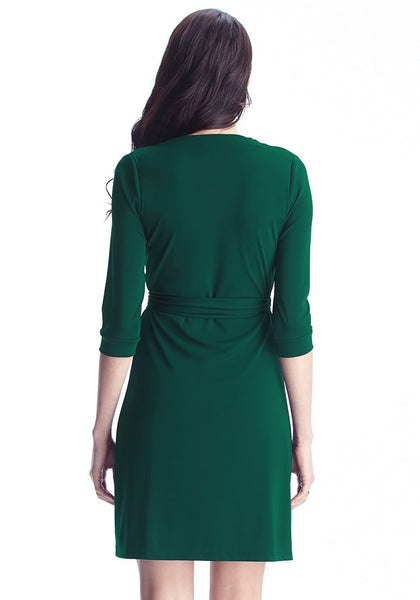 back view of model in Angled shot of model in green plunge wrap-style belted dress