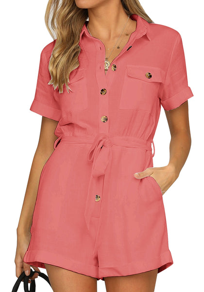 Front view of model wearing coral pink short sleeves button-down belted romper
