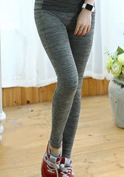 dark grey melange yoga leggings worn with red and white rubber shoes