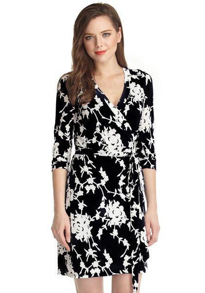 front shot of model in Black Floral Plunge Wrap Dress