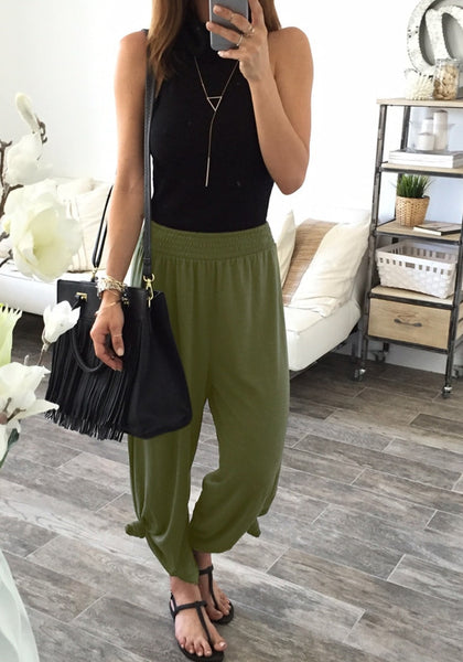girl in army green elastic waist lounge pants and black top