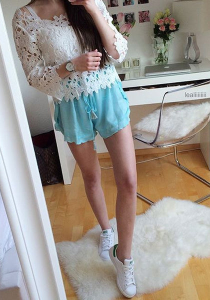 lealiiiiiiii is wearing lookbookstore light blue ruffled petal shorts