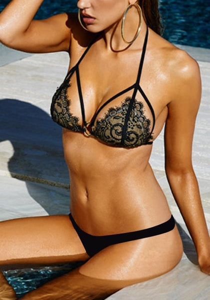 left angled shot of model in a black floral lace bikini set