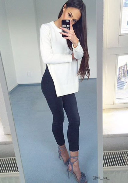 Front view of ni_sa_ wearing beige side slit tunic sweater