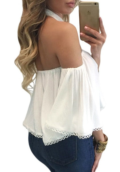 right side shot of model in  white halter off-shoulder crop top