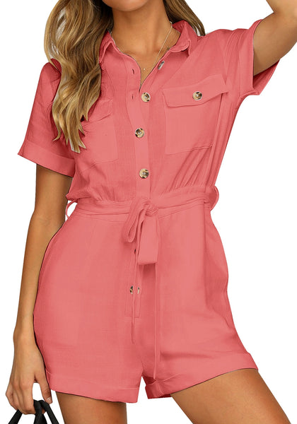 Model poses wearing coral pink short sleeves button-down belted romper