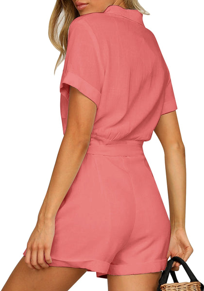 Back view of model wearing coral pink short sleeves button-down belted romper