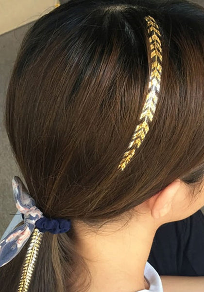 silver and gold temporary hair tattoo