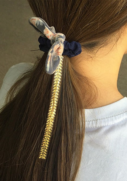 silver and gold temporary hair tattoo tie at the hair