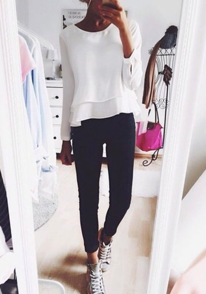 white layered chiffon blouse worn with black pants and sneakers