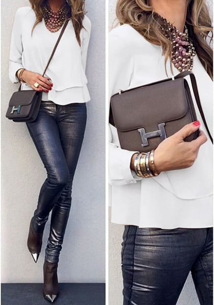 white layered chiffon blouse worn with metallic pants