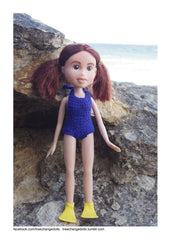 Tree Change Doll on the beach