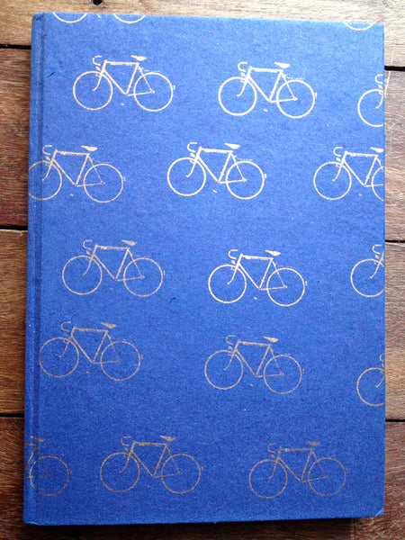 gold bicycles on blue handmade jute pulp paper