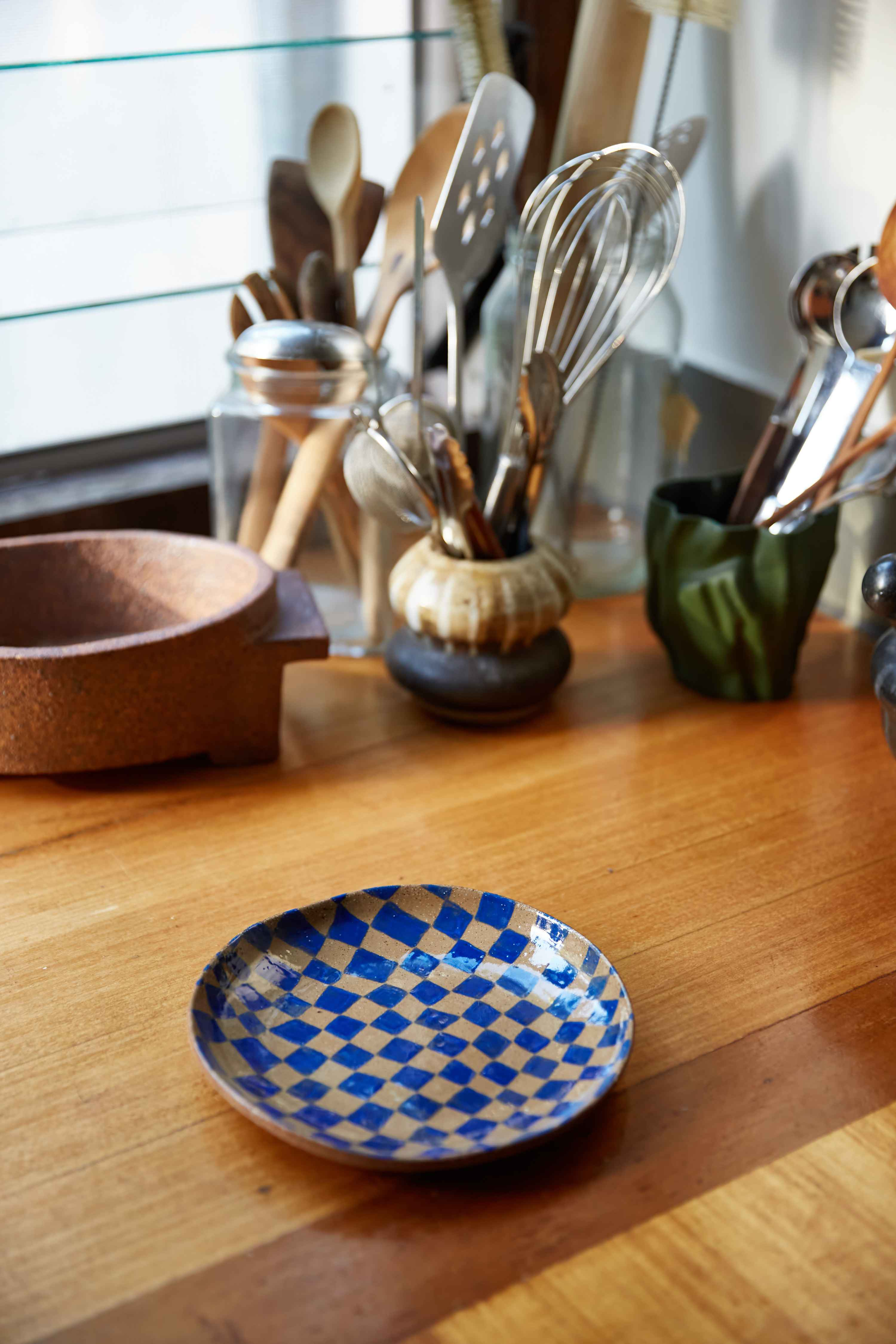 A selection of Soft Edge pieces: the 'Conversation Cup','Cup with Curves' and a side plate in Klein Blue