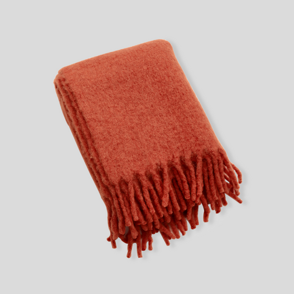 Alpaca throw rug in Rust