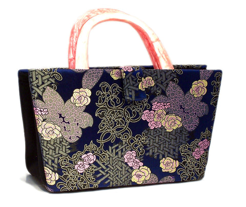 Ethyl in blue sakura silk brocade