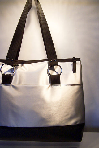 travel bag in silver luster vinyl