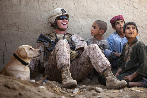 American Soldier with dog and children