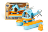 Green Toys Seacopter in packaging, next to a second, unpackaged Seacopter (Color: Light Blue & Orange) (Front View with included Bear Aviator Toy standing beside the Seacopter)