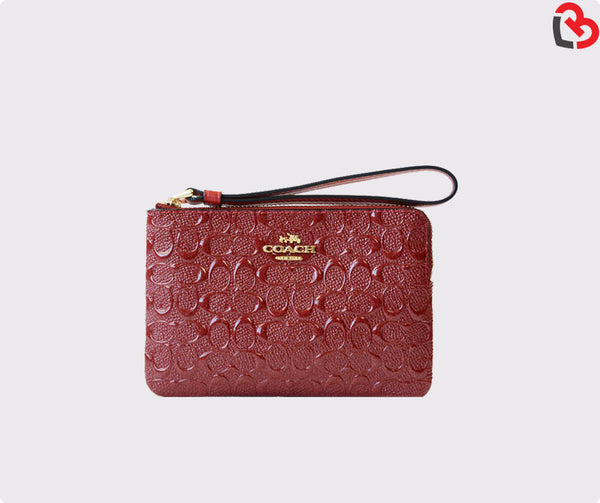 Coach Corner Zip Wristlet In Signature Debossed Patent Leather