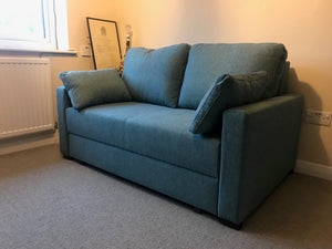 small blue fabric sofabed