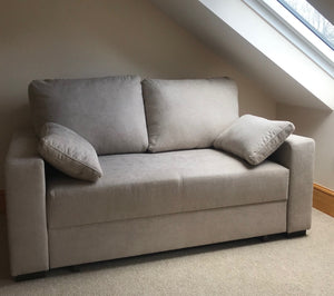 white 2 seat sofa bed in loft