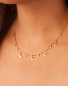 Gold Scattered Horseshoe Diamond Necklace