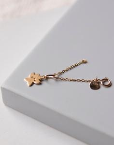 Paw print charm in 18 kt gold