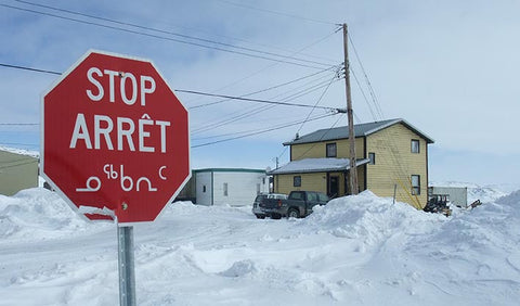 Trilingual stop sign in Iqualuit Baffin Island
