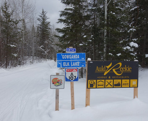 Snowmobile trail signs Gold Rush Tour
