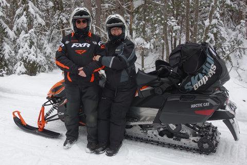 Karen Richardson and her husband snowmobiling