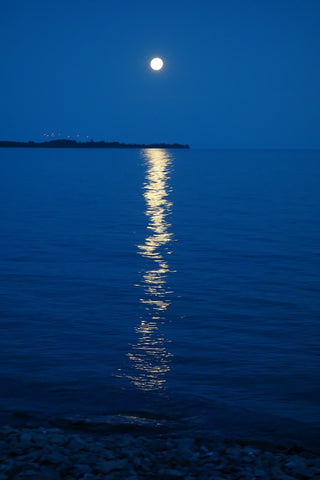 Full moon over Lake Ontario photo by Karen Richardson