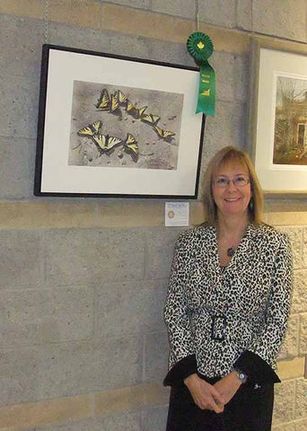 Karen Richardson with her award winning watercolour, Sunbathing Swallowtails