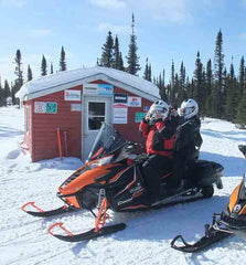 John and Karen snowmobiling near Labrador City