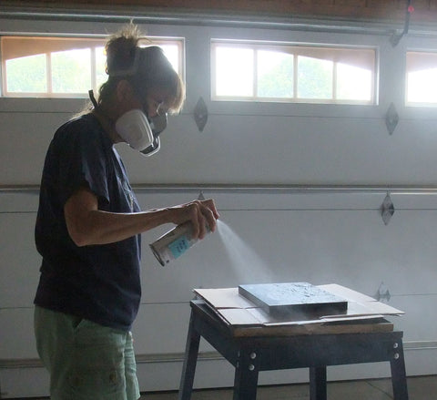 Karen Richardson varnishing a painting