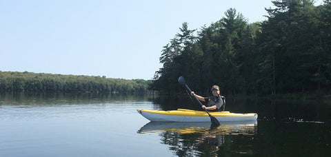 Karen Richardson kayaking on Brownlee Lake, east of Lake Superior, Ontario