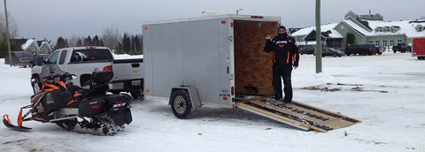 Unloading our snowmobile at Cedar Meadows Resort