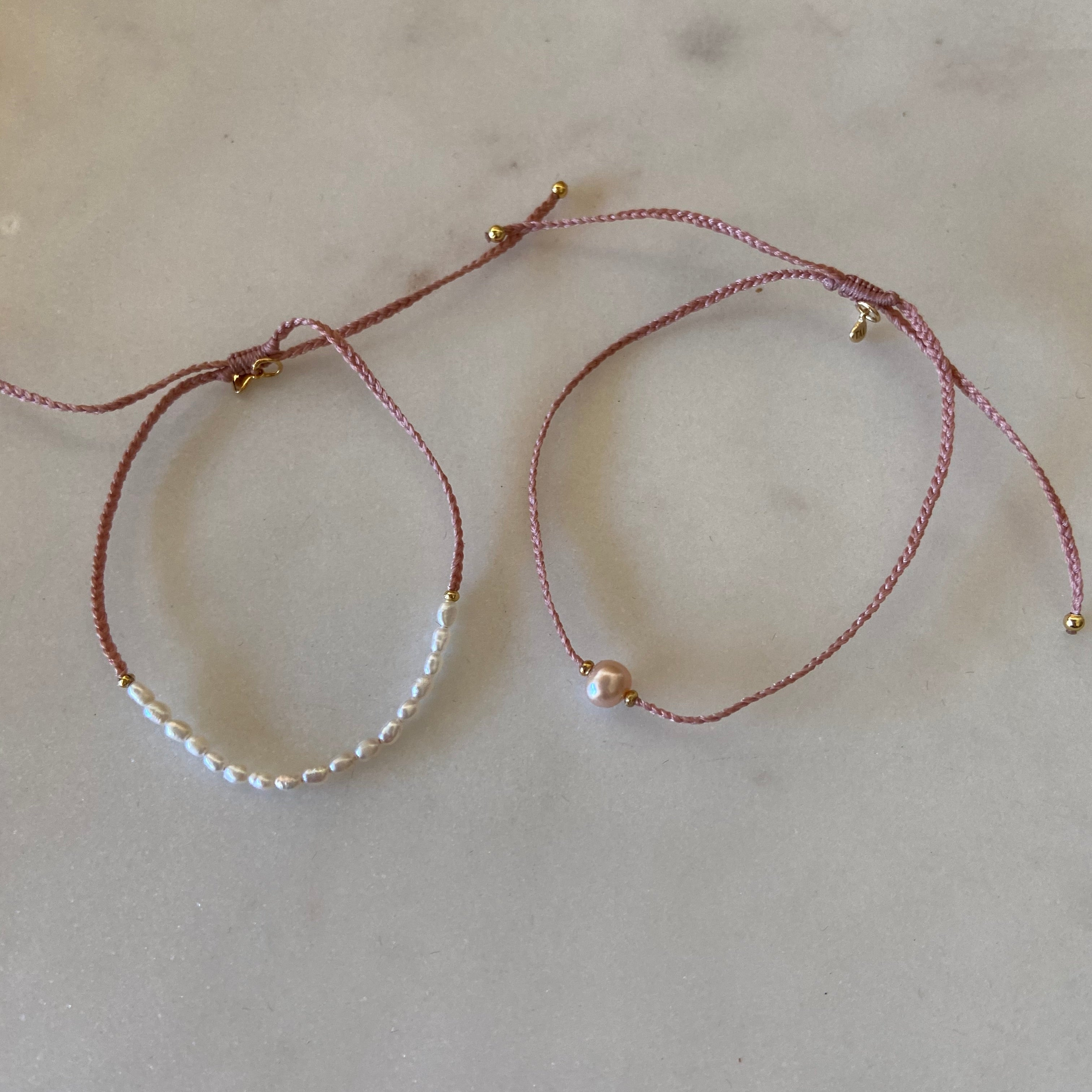 pearls and pink thread.   bracelet