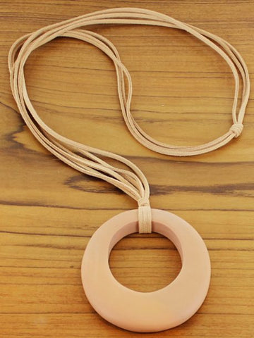 Oval shape pendant on long suede cord